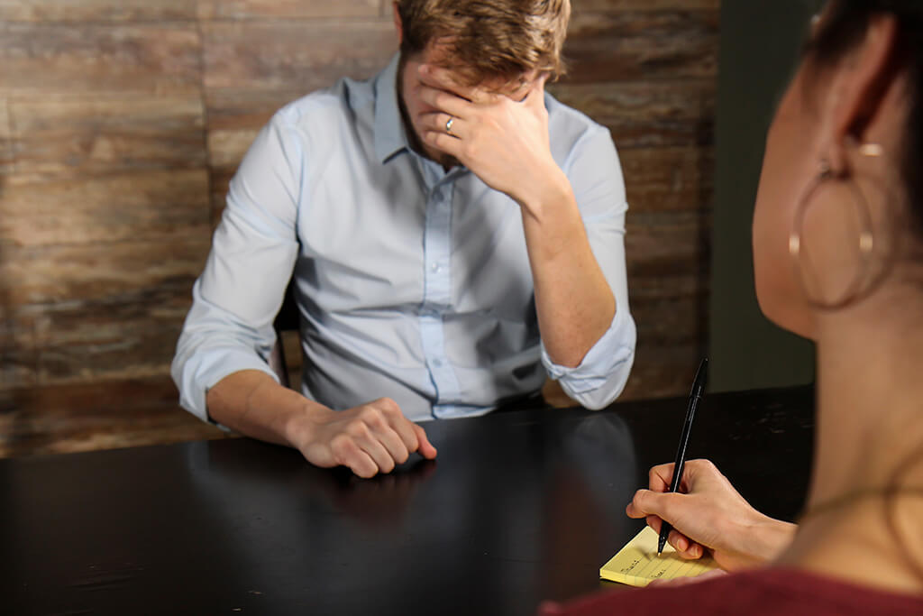 Two people in a counseling meeting