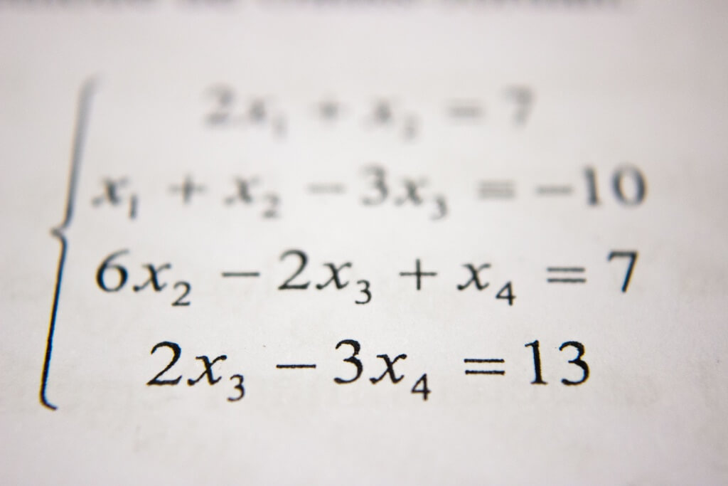 An algebra equation on a piece of paper